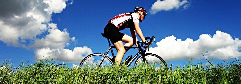 Man Biking on a Grassy Trail