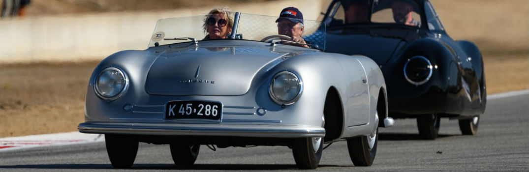 Wolfgang Porsche driving a porsche at a large event