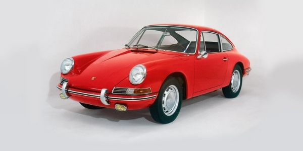 Red 1964 Porsche 911 on a Light Background