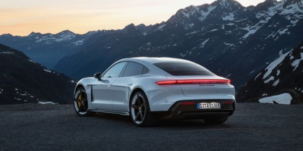 White 2020 Porsche Taycan Rear Exterior in the Mountains at Dusk