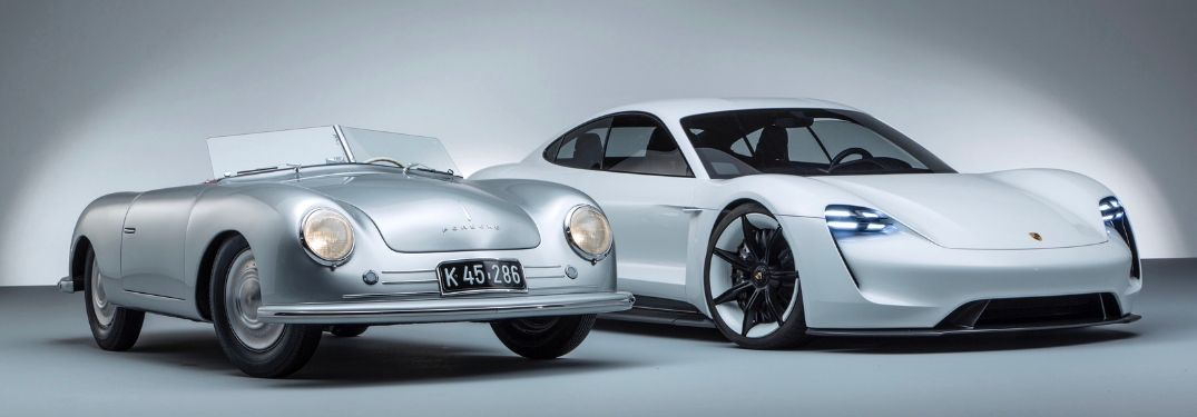 Silver 1948 Porsche 356/1 Next to a White 2018 Porsche Mission E Concept on Gray Background