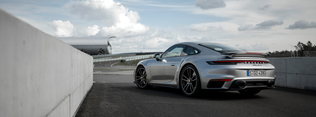 Rear view of silver 2021 Porsche 911 Turbo S