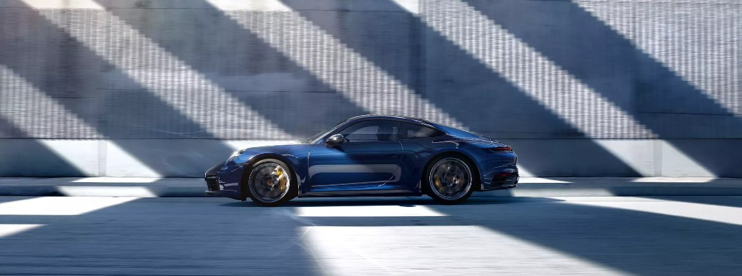 Side view of blue 2020 Porsche 911 Carrera 4S