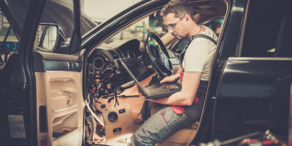 Mechanic working in vehicle