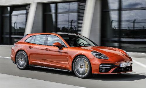 Side view of orange 2021 Porsche Panamera