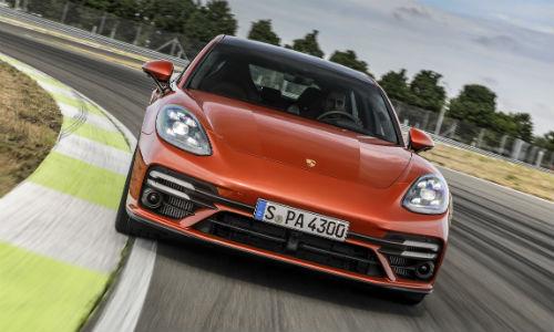 Front view of orange 2021 Porsche Panamera