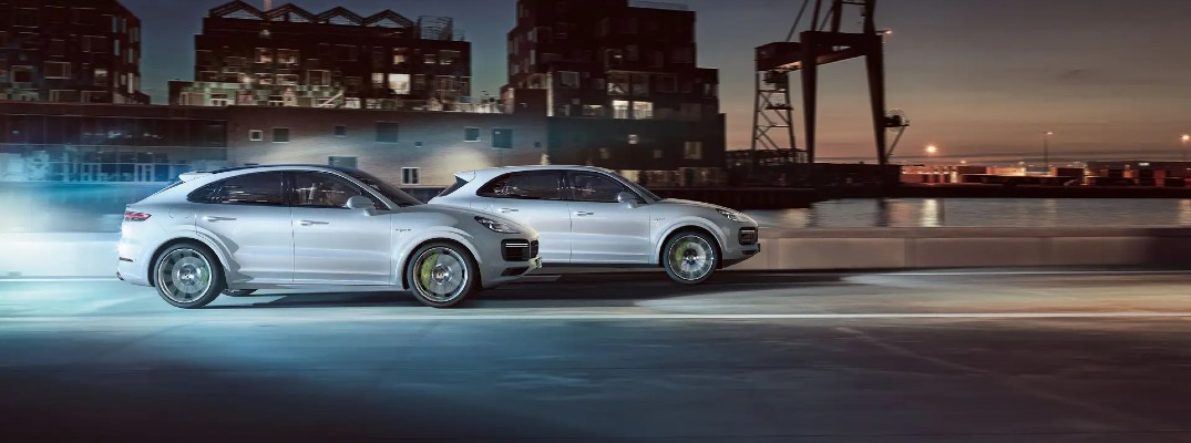 Two silver 2021 Porsche Cayenne models driving