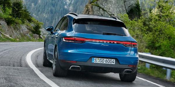 Rear view of blue Porsche Macan model