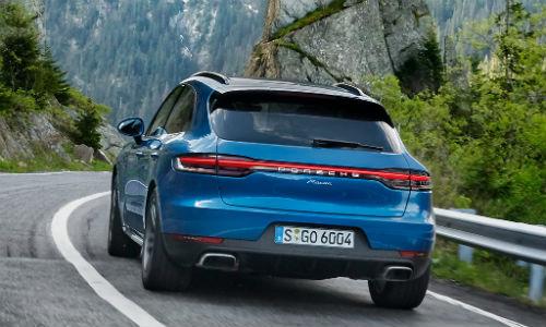 Rear view of blue 2018 Porsche Macan