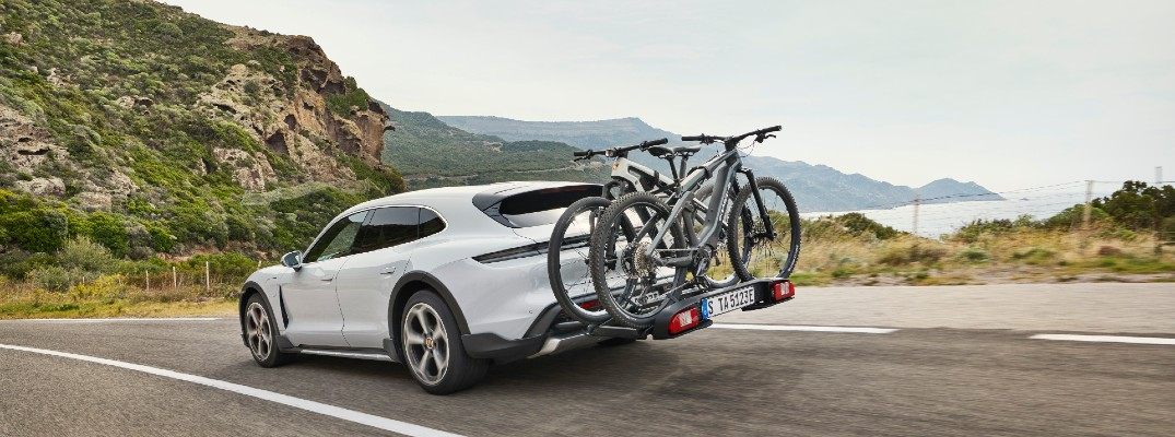 White 2021 Porsche Taycan Cross Turismo with bikes on back