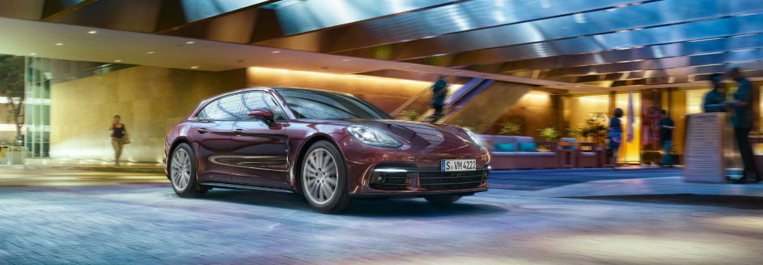 2018 Porsche Panamera Exterior Color Options with image of a Panamera driving near a mall entrance