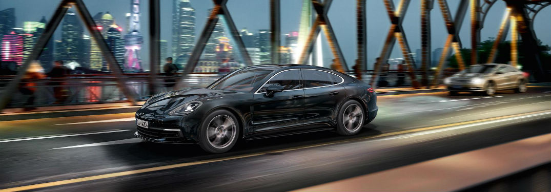 2018 Porsche Panamera Convenience Features with image of a Porsche Panamera driving across a bridge