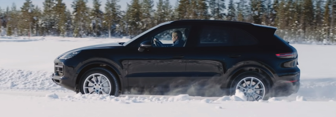 Black Porsche Cayenne Driving on a snowy road