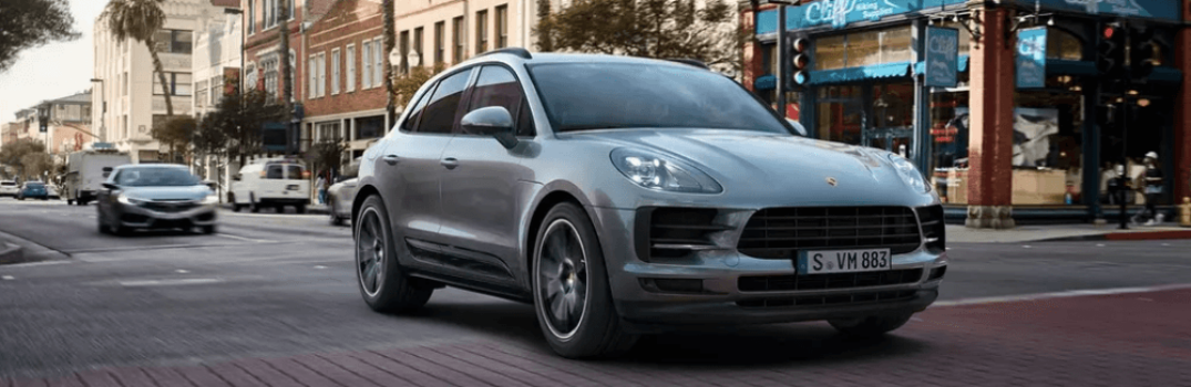 2020 Porsche Macan driving through a city