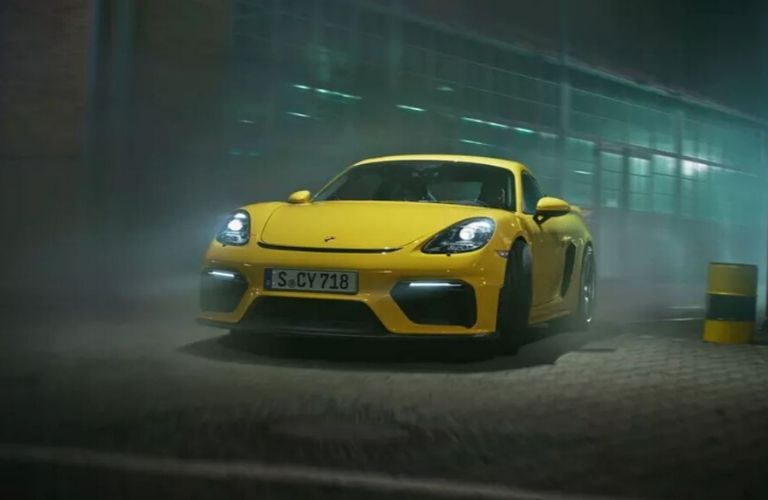 Exterior view of the front of a yellow 2020 Porsche 718 Cayman GT4