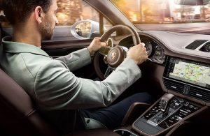 man driving 2020 Porsche Cayenne