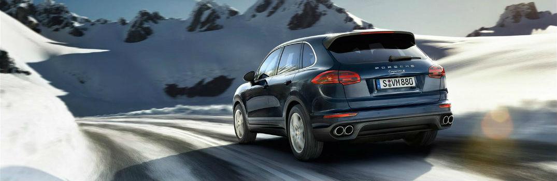 Porsche SUV driving on a winter road