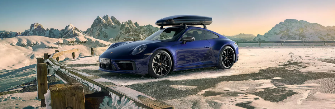 2020 Porsche Panamera with roof rack overlooking cliff in winter