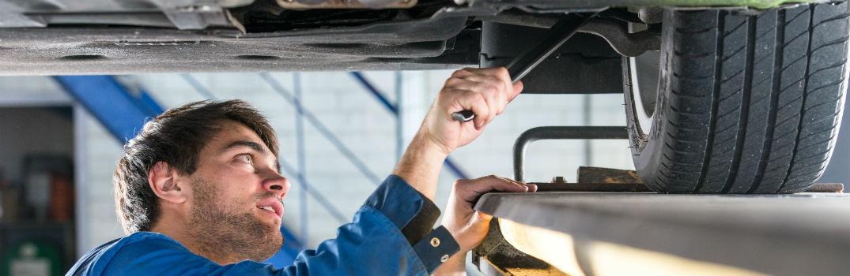 mechanic aligning wheels on a vehicle
