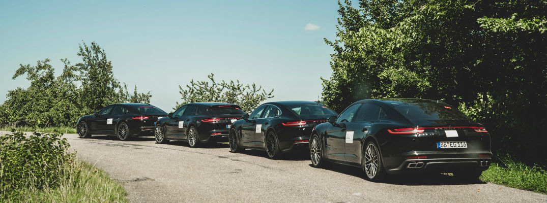 A line of 2020 Porsche Panamera models waiting to get on the test track.