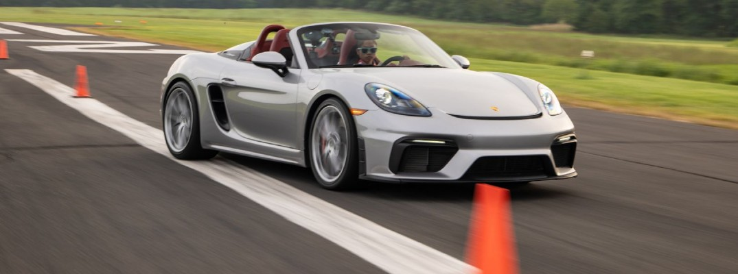 A photo of Chloe Chambers behind the wheel of a 2020 Porsche 718 Spyder while setting a world record.