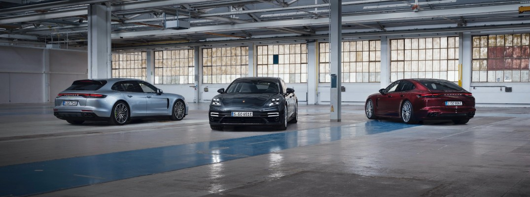 A photo of three new 2021 Porsche Panamera models in the garage.