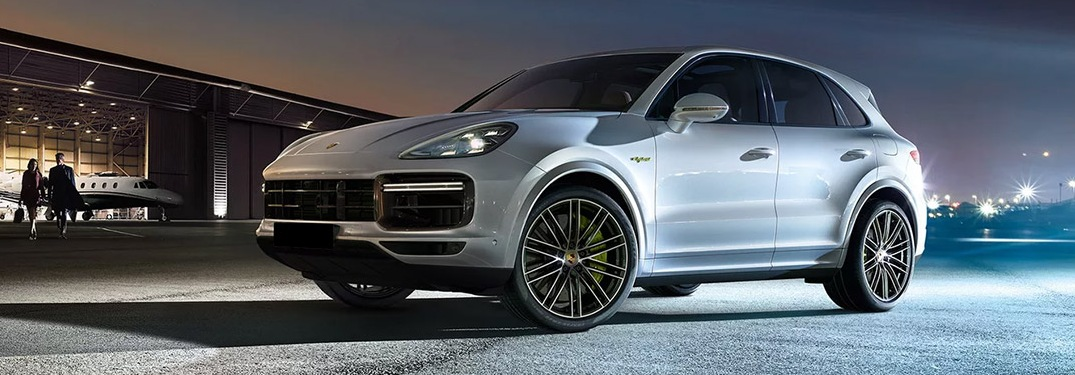 2020 Porsche Cayenne SUB parked outside of an airplane hangar