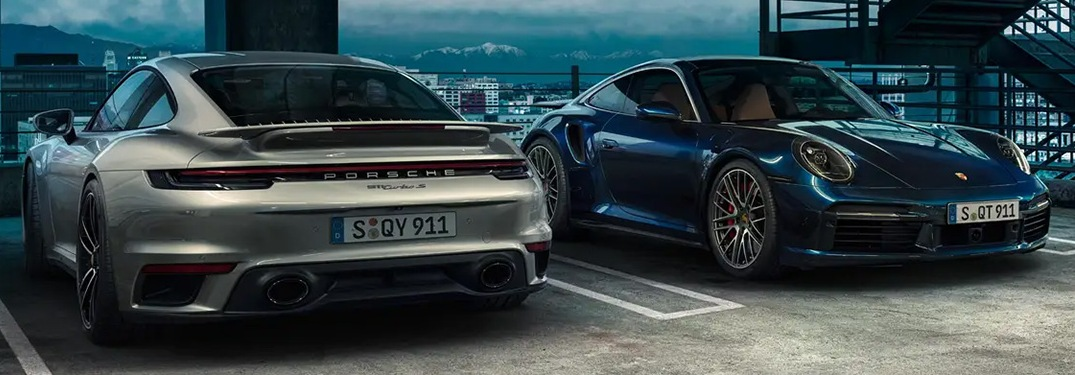 Two 2021 Porsche 911 cars parked next to each other