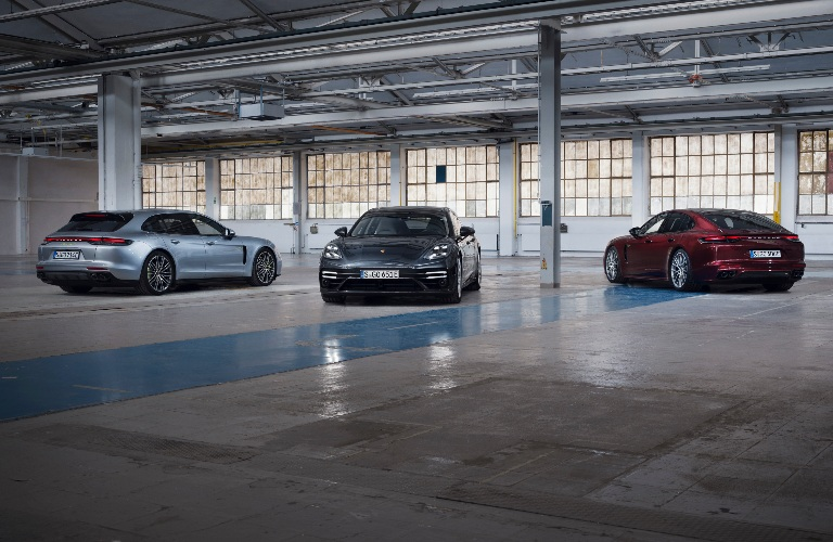 2021 Porsche Panamera 4S and hybrid models parked by each other