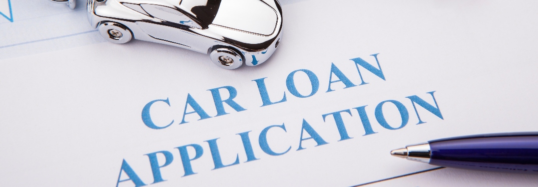 Car loan application with little car and pen