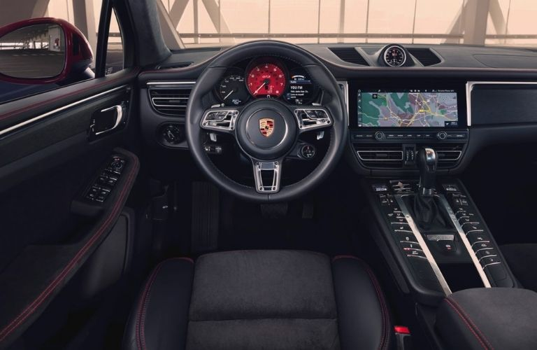 2021 Porsche Macan dashboard view with steering wheel and gearbox