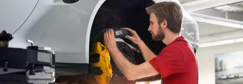 Porsche professional servicing a car