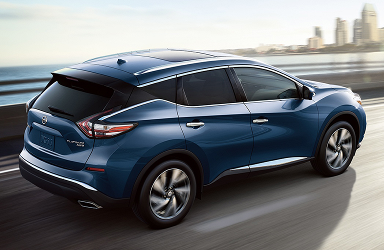 2018 Nissan Murano in blue driving over a bridge