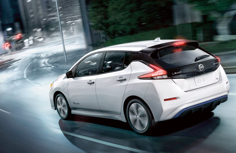 2019 Nissan LEAF in white driving at night