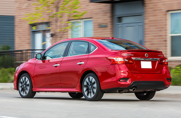 2019 Nissan Sentra in red driving down a city street