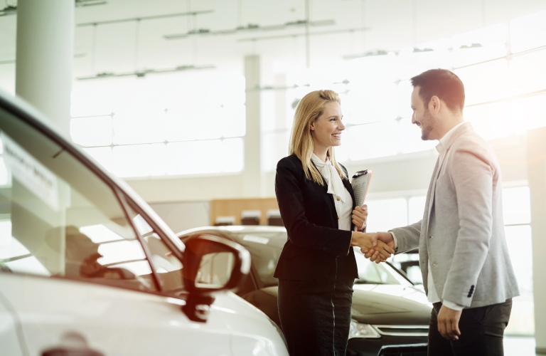 Saleswoman and Man Shaking Hands