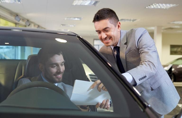 Salesman and man looking over paperwork