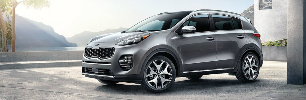 2018 Kia Sportage Gray with Sunny Background In Concrete Garage like Place