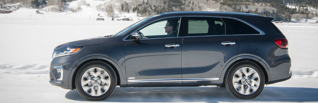 2019 Kia Sorento Driving to the left in the snow with a man at the wheel