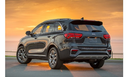 2019 Kia Sorento at sunset facing away from camera lots of orange