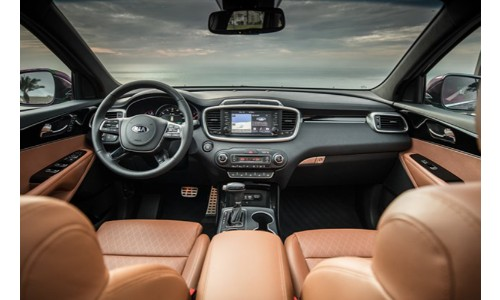 2019 Kia Sorento interior shot of front row beige upholstery facing out towards road like exterior