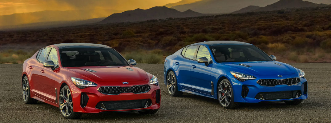 A photo of two 2019 Kia Stingers sitting side-by-side.