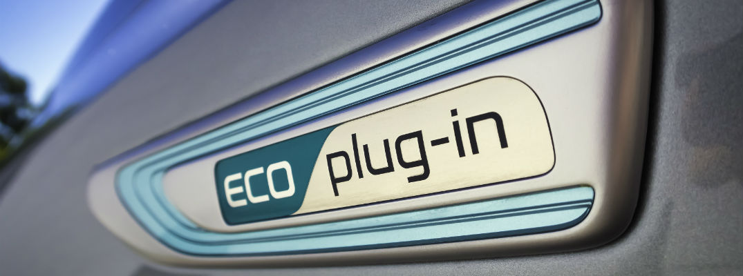 A photo of the Eco Plug-In badge that is worn on some Kia vehicles.