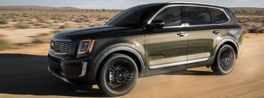 Green 2020 Kia Telluride driving in desert