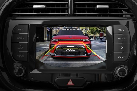 Rear view monitor display inside the 2020 Kia Soul showing a front view of a red Kia in the image