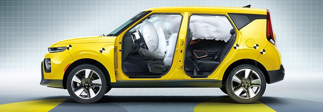 Driver angle of a yellow 2020 Kia Soul test model with airbags used