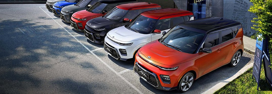 Front driver aerial view of 2020 Kia Soul models in different colors parked next to each other in a lot
