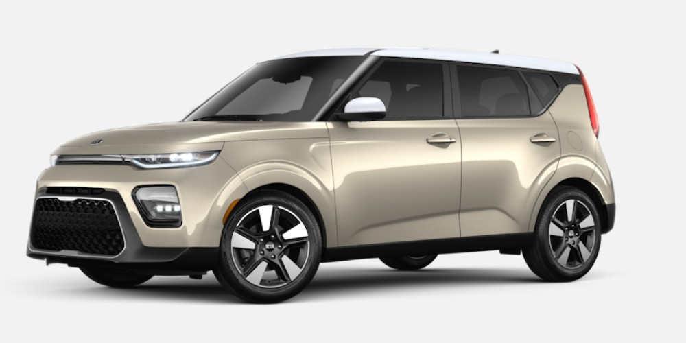 Front driver angle of the 2020 Kia Soul in Platinum Gold color with Clear White roof