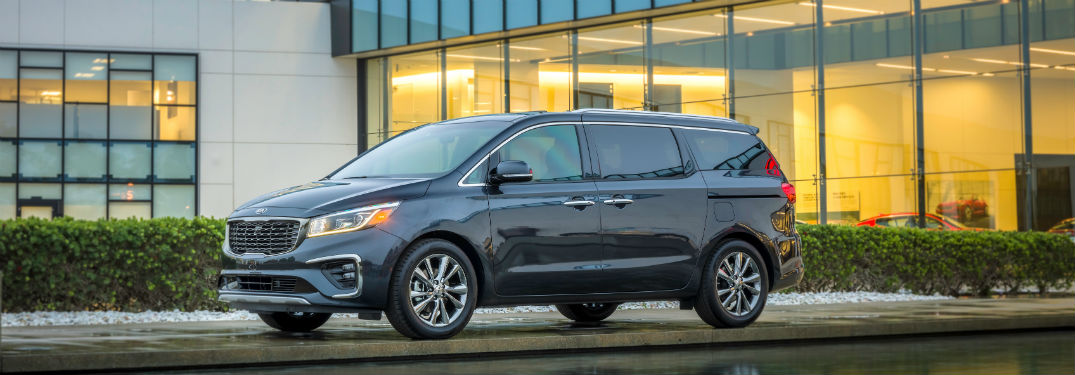 side view of a black 2020 Kia Sedona