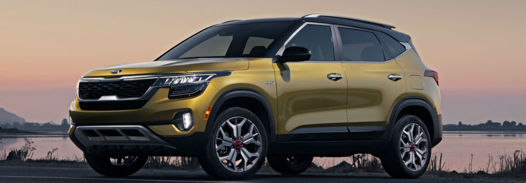 side view of a gold 2021 Kia Seltos